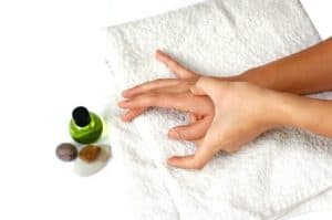 Self hand massage as part of alternative treatment or spa setting.